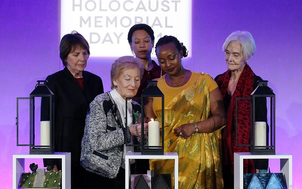 Actors (back row left to right) Dame Penelope Wilton, Nina Sosanya and Sheila Hancock join Holocaust survivor Mindu Hornick (front left) and Rwandan genocide survivor Chantal Uwamahoro (front right) in lighting a candle in memory of all victims of genocide at a Holocaust Memorial Day ceremony held the QEII Centre, Westminster, London.  Photo credit: Jonathan Brady/PA Wire