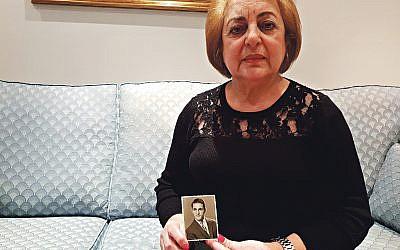 Faiza Saigh holding a photo of her brother, Daoud Ghali Yadgar