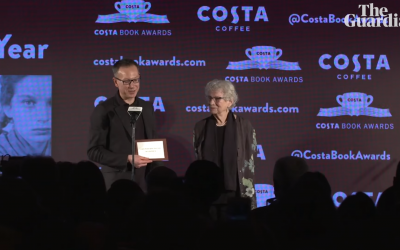 Professor Bart van Es (left) accepting the prestigious award, alongside  85-year-old Lien de Jong