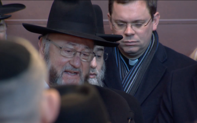 Chief Rabbi Ephraim Mirvis speaks personally to the child victim during the service.