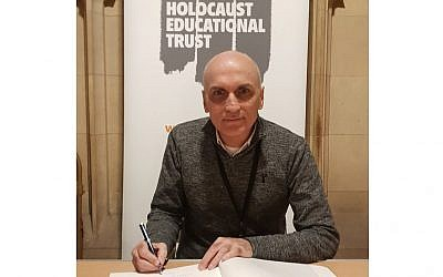 Chris Williamson MP singing the book of commitment