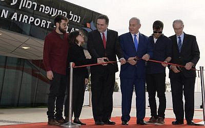 Bibi Netanyahu cuts the ribbon opening the new international airport. Source: Israeli PM on Twitter