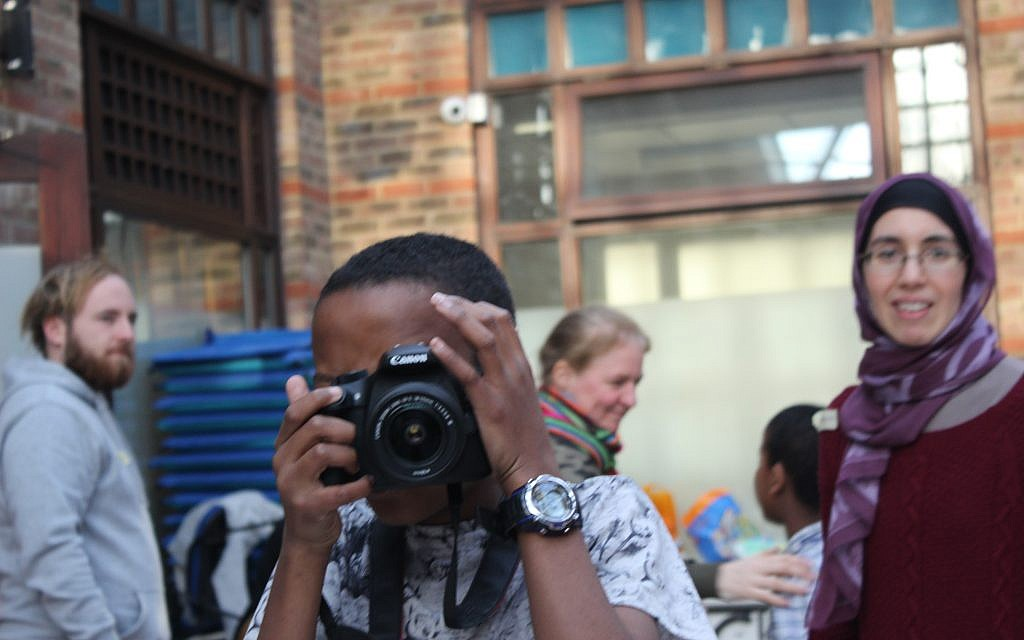 Say cheese! Young man takes a snap on a camp for children who were traumatised by the Grenfell disaster, run in-part by Jewish activists