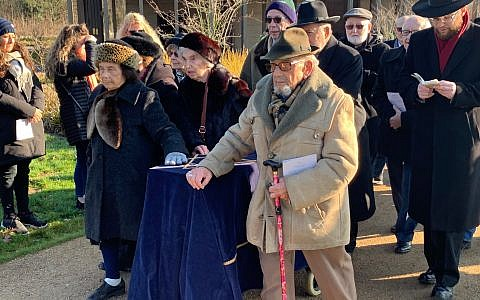 Survivors escorting the coffin containing the remains of six Holocaust victims to their grave at Bushey New Cemetery.
