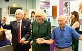 Duchess of Cornwall links arms with Jewish Care president Lord Levy (left) and a Brenner Centre user during a rendition of Hava Nagilah. (Credit: Sam Churchill Photography)