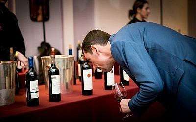 A guest at the Kedem Food and Wine event 2018 inspects some of the wines on offer