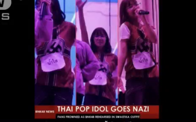 Screenshot from video, showing Thai band BNK48 with Nazi Tshirts on.
