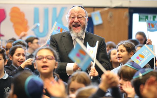The Chief Rabbi performing with schoolchildren.