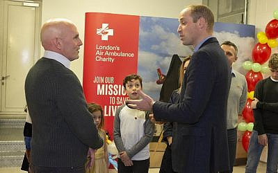 Yair Shahar (left) and his family meeting Prince William (Credit: Ian Vogler)