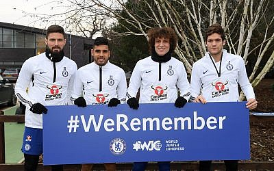 Chelsea players at the club's training ground holding up a #WeRemember sign. L-R: Olivier Giroud, Emerson Palmieri, David Luis and Marcos Alonso     (Photo by Darren Walsh/Chelsea FC via Getty Images)