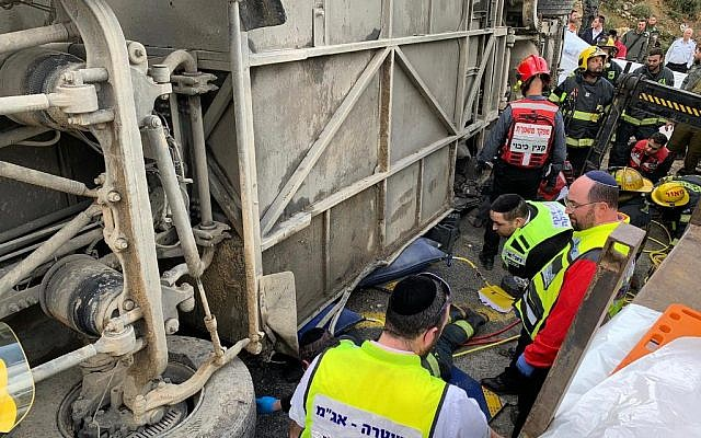 Emergency services attend the scene of the Route 443 crash  (Photo credit: ZAKA/Natan Koenig)