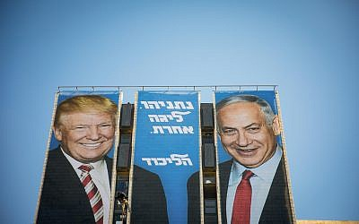 An election campaign billboard of the ruling Likud party reading 'Netanyahu is a different league' shows Israeli Prime Minister Benjamin Netanyahu (R) and US President Donald Trump (L)