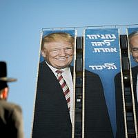 An election campaign billboard of the ruling Likud party reading 'Netanyahu is a different league' shows Israeli Prime Minister Benjamin Netanyahu (R) and US President Donald Trump (L) shake hands at the entrance to Jerusalem.. Photo by: JINIPIX