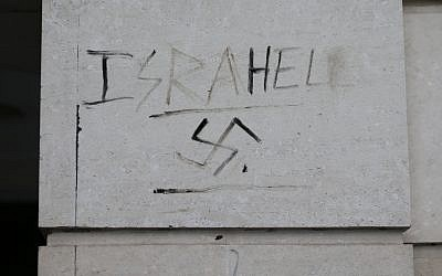 Graffiti saying 'Israhell' next to a swastika on a wall in Victoria, London, as antisemitic incidents rise for a third year in a row. (Photo credit should read: Yui Mok/PA Wire)