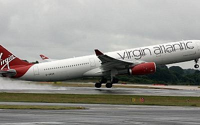 A Virgin Atlantic A330 leaving grey and wet London for sunnier climes