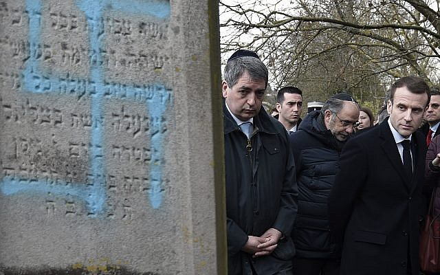 Jewish graves desecrated near Strasbourg (Frederick Florin, Pool via AP)