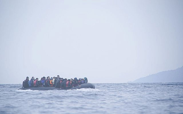 Migrants crossing the Aegean Sea from Turkey to the Greek island of Lesbos, January 2016, on a rubber dinghy .(Wikipedia/Mstyslav Chernov/Unframe)