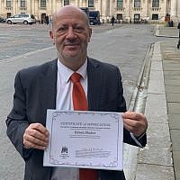 Edwin Shuker with his certificate from the foreign office