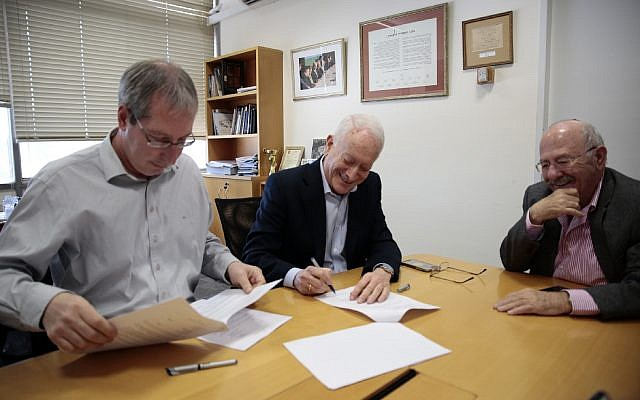 Signing of National Library of Israel - Haaretz Agreement Courtesy National Library of Israel