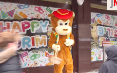 Someone in fancy dress on Golders Green high street for Purim 2018, as pictured in Jewish News' Purim video.