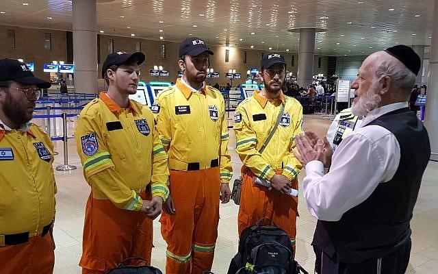 ZAKA Chairman Yehuda Meshi-Zahav gives the Israel team a final briefing before they depart for Ethiopia. Credit: ZAKA