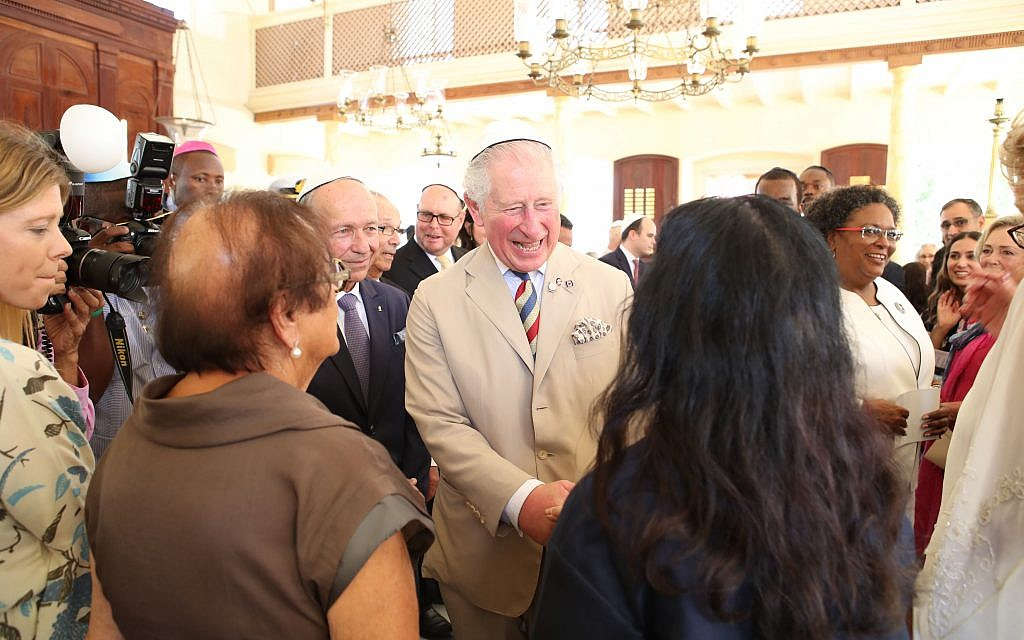 The Prince of Wales puts on his kippah as he arrives for his visit to the Nidhe Israel synagogue, Bridgetown, Barbados, where he unveiled a plaque and saw the Mikvah, as he continues his tour of the Caribbean. (Photo credit: Jane Barlow/PA Wire)