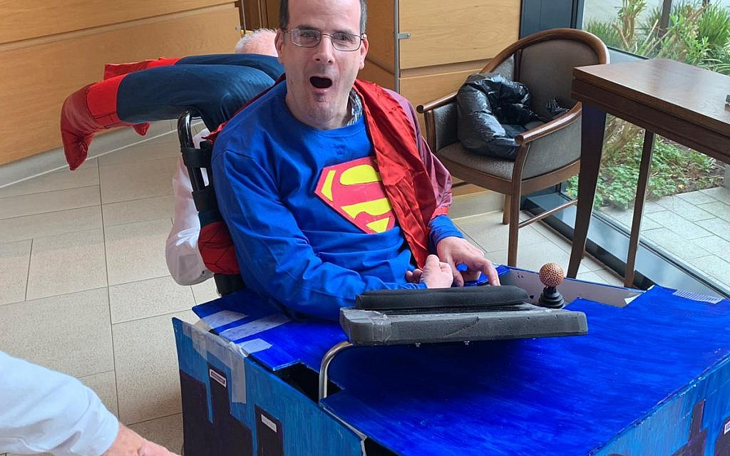 Simon in his Superman costume designed and made by his sister!
