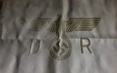 Nazi memorabilia emblazoned with a swastika was pulled from the auction.