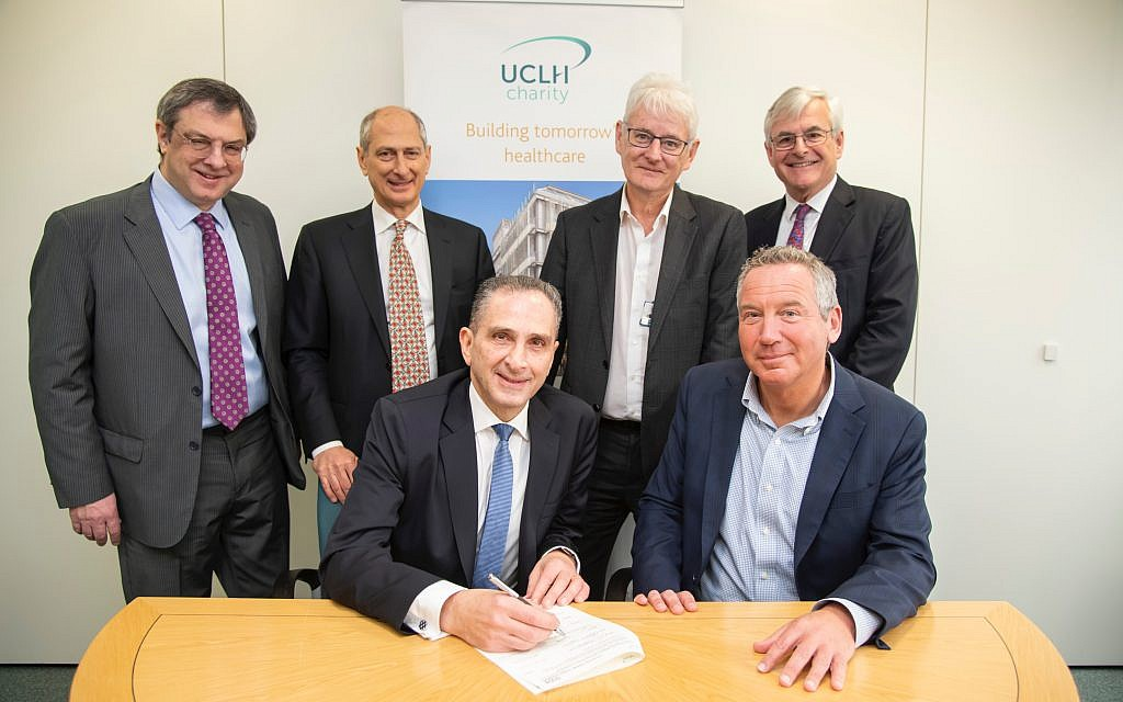 The back row, From left to right  Elie Dangoor, David Dangoor, Professor Geoff Bellingan, medical director, surgery and cancer, Philip Brading, chief executive, UCLH Charity (end, back). Professor Marcel Levi, UCLH NHS Foundation Trust (front), Michael Dangoor, (front left).  (Photographer: Adam Scott)