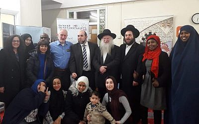 Jeremy Corbyn in the back row with a light blue shirt, and Rabbi Gluck two to the right of him.