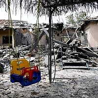 Children's swing among rubble after a house in Israel is struck by a Hamas terror rocket