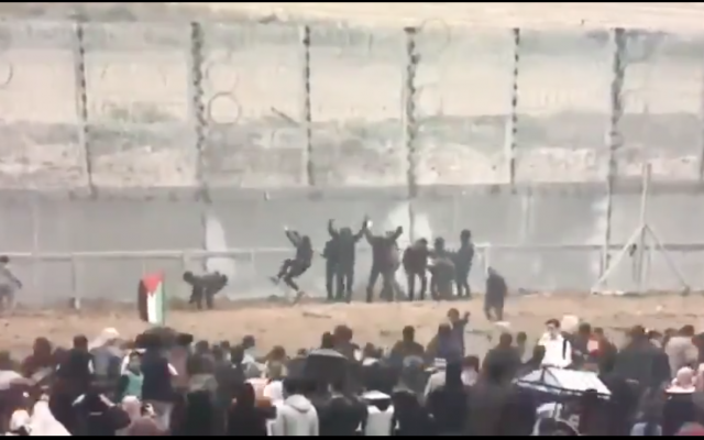 Screenshot from video on Youtube showing Palestinian demonstrators trying to infiltrate the Gaza fence with Israel