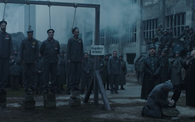 The German band Rammstein is taking heat for portraying concentration camp prisoners in a video. (Screenshot from YouTube via JTA)