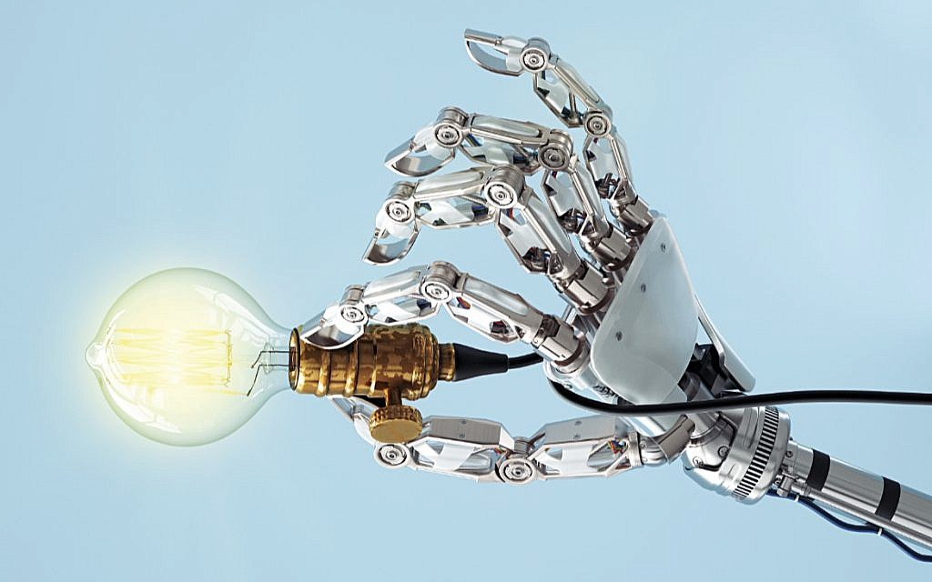 High tech hand with a classic light bulb. How much will AI control its creator?