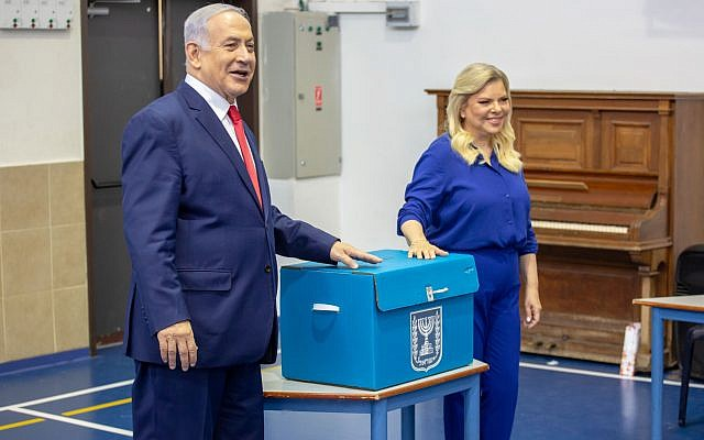 Israel's Prime Minister Benjamin Netanyahu casts his vote with his wife Sara during Israel's parliamentary election in Jerusalem April 9, 2019. Photo by: Emil Salman-JINIPIX