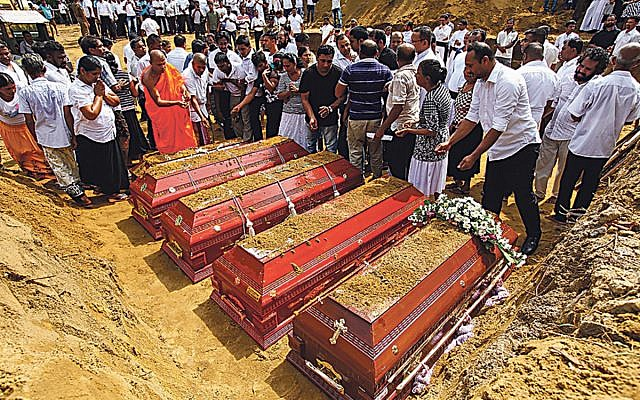 Sri Lankans prepare to bury the coffins carrying remains of victims killed in the Easter Sunday bombings in Colombo, Sri Lanka, April 23, 2019.  Photo by Perera Sameera/UPI