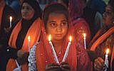 Candles are lit in Pakistan to pay tribute to the Sri Lankan blasts victims, during a vigil in Lahore on April 23, 2019.   (Photo credit ARIF ALI/AFP/Getty Images)