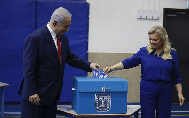 Israel's Prime Minister Benjamin Netanyahu casts his vote with his wife Sara during Israel's parliamentary elections in Jerusalem, Tuesday, April 9, 2019 (AP Photo/Ariel Schalit, Pool)
