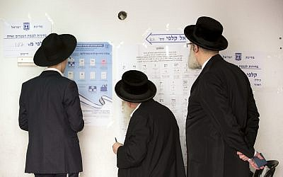 Ultra-Orthodox Jews line up to vote for Israel's parliamentary election at a polling station in Bnei Brak, Israel, Tuesday, April 9, 2019. (AP Photo/Oded Balilty)
