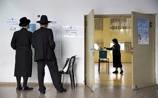 Ultra-Orthodox Jews at a polling station in Bnei Brak, Israel, Tuesday, April 9, 2019. (AP Photo/Oded Balilty)
