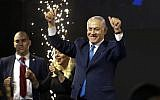 Israel's Prime Minister Benjamin Netanyahu waves to his supporters after polls for Israel's general elections closed in Tel Aviv, Israel, Wednesday, April 10, 2019. (AP Photo/Ariel Schalit)