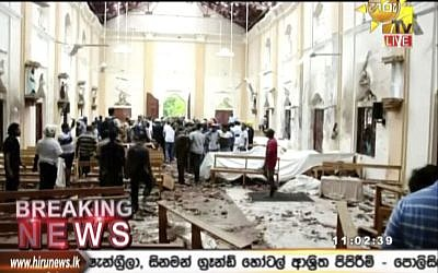 This image made from video provided by Hiru TV shows damage inside a church after a blast in Colombo, Sunday, April 21, 2019. Near simultaneous blasts rocked three churches and three hotels in Sri Lanka on Easter Sunday. (Hiru TV via AP)