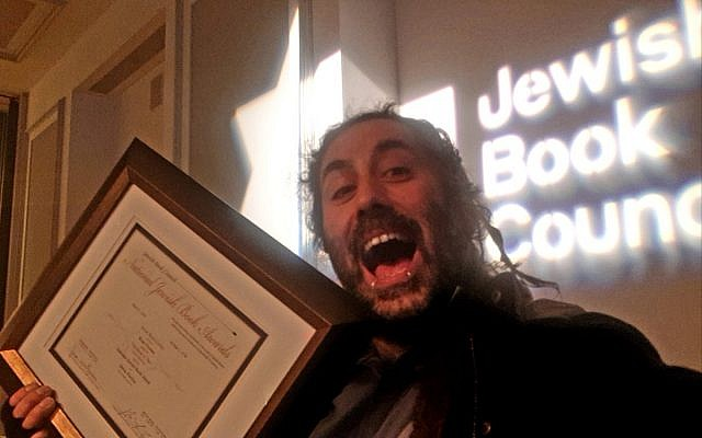 Bram Presser picking up the debut fiction prize at the National Jewish Book Awards (Twitter)