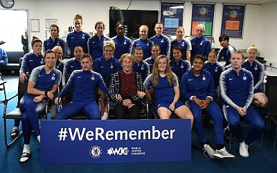 Susan Pollack (centre) with Chelsea Women players, as they heard testimony from the 88-year-old survivor this week.