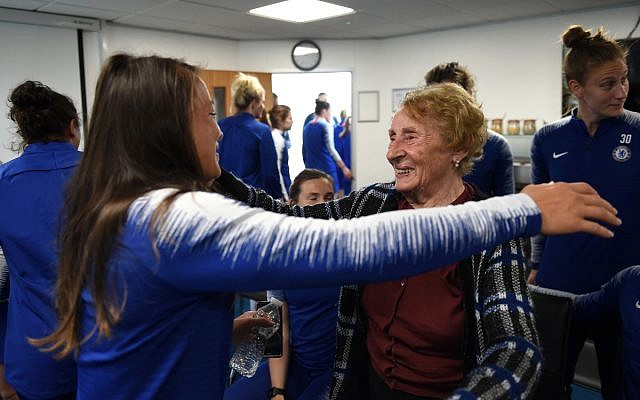 Susan embraces a player from the Chelsea Women team, after they heard testimony from the 88-year-old survivor this week.