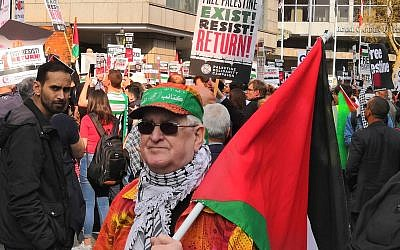 Pro-Palestine demonstrator with questionable bandanna