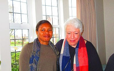 Cheryl Sklan (right) at her home with a refugee guestb