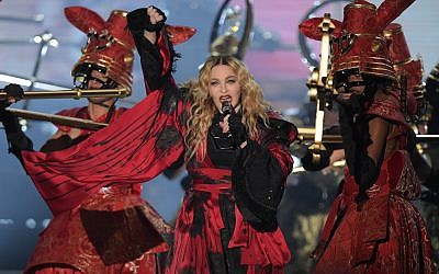 Madonna performs on stage at the Mercedes Benz Arena in Berlin, Germany, 10 November 2015. Photo: RAINER JENSEN/dpa