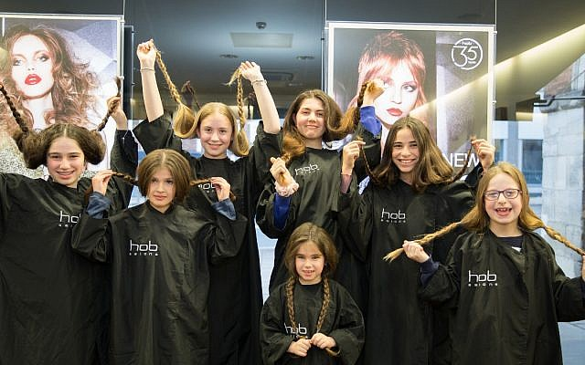 A group of girls had their braids chopped off  to make wigs for Israeli children diagnosed with cancer