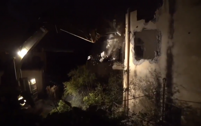 Screenshot from IDF video shows the military demolishing another suspected terrorist, Saleh Barghouti's home, in April